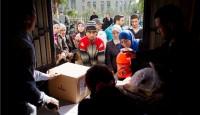 providing humanitarian aid to Syrians