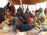 Newly arrived Malian refugees in Niger wait for registration and for their first food rations. Photo: Ryan Worms/Caritas Internationalis