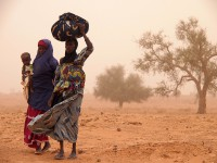 Domo Damani and her granddaughter trek home after visiting a Caritas centre in Niger
